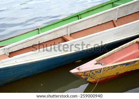 wooden boat on the river - stock photo