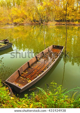 Wooden boat on the river in autumn