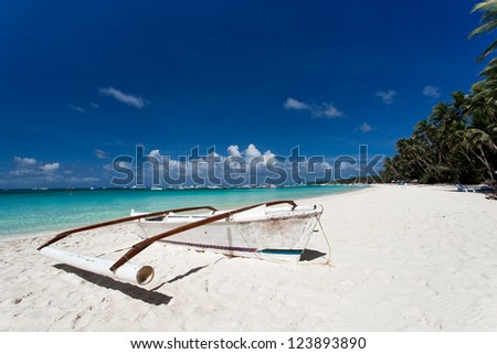 Wooden boat on tropical beach with white sand,  Boracay - stock photo