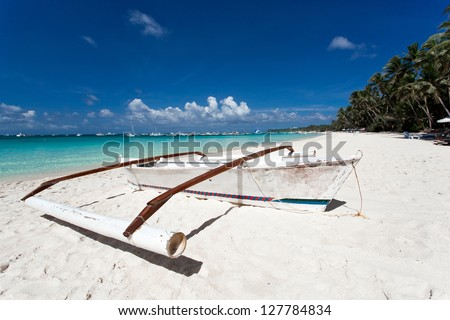 Wooden boat on tropical beach with white sand, Philippines - stock photo