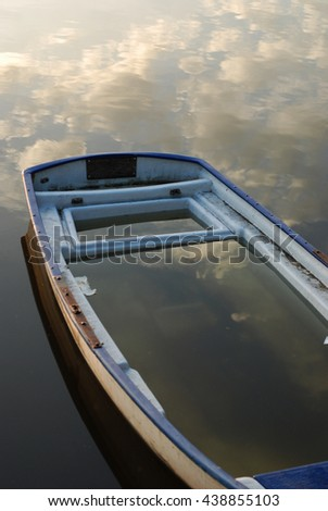 wooden boat with clouds