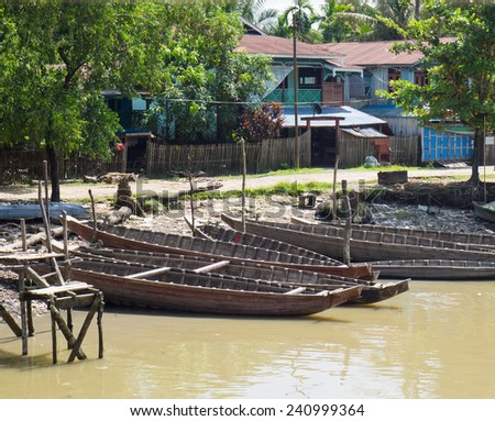 Wooden boats along the riverside in Mrauk U, Western Rakhin State, Myanmar.
