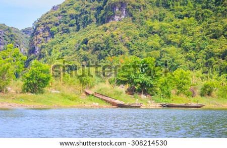 Wooden boats anchoring on riverbank  - stock photo