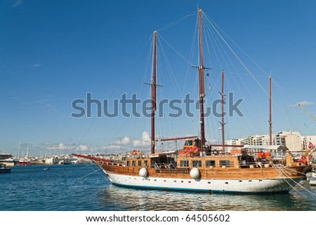 Wooden boats are waiting for blue yachting in Malta - stock photo
