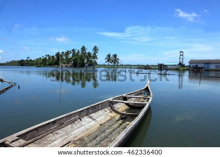 Wooden boats docked in the beautiful backwater location of Kerala, India.