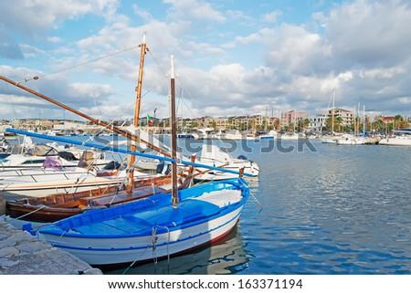 wooden boats in Alghero harbor - stock photo