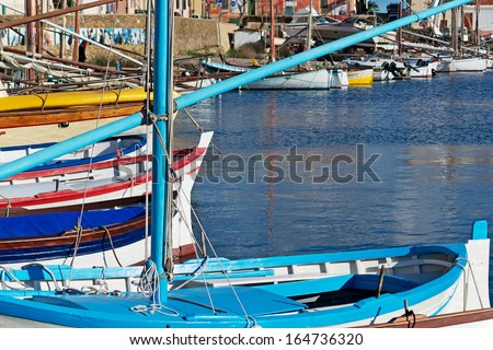 wooden boats in Stintino small harbor - stock photo