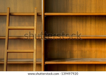 Wooden bookshelf with ladder  - stock photo