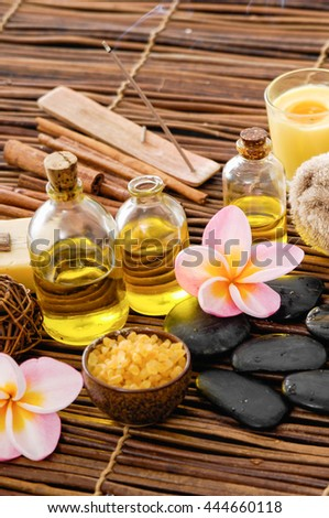 wooden bowl in salt with frangipani with spa set on mat