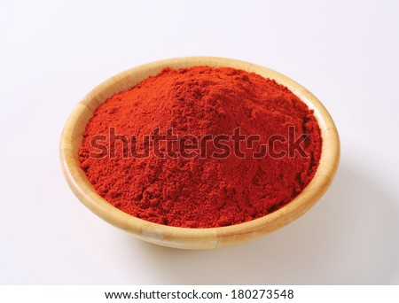 wooden bowl of ground red pepper
