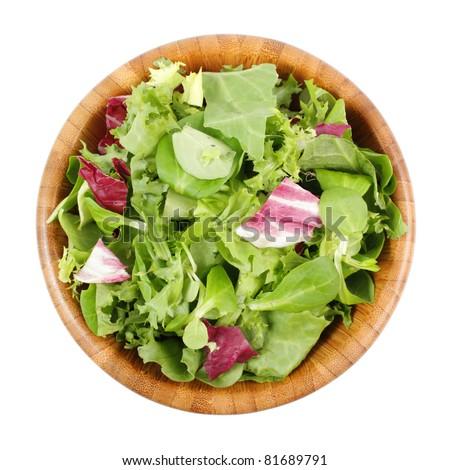 Wooden bowl of mixed salad - stock photo