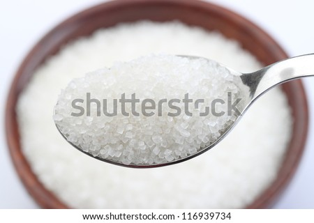 wooden Bowl of sugar with metal spoon
