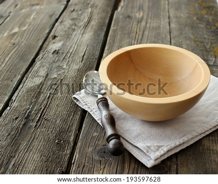 wooden bowl on old wooden boards - stock photo