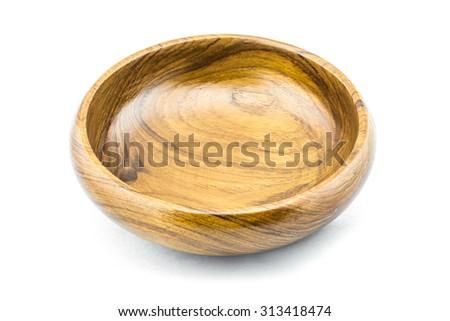Wooden bowl on white background - stock photo
