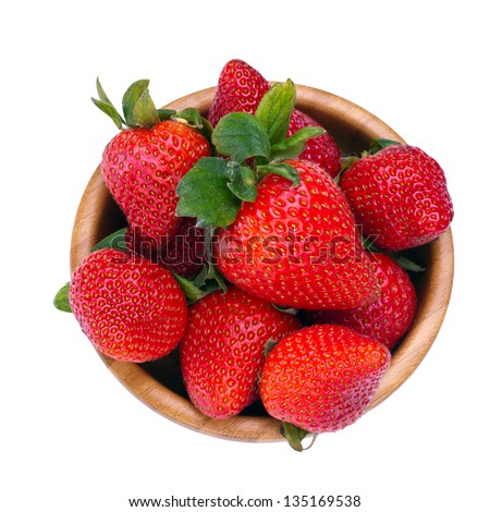 Wooden bowl with fresh strawberries shot from above - stock photo