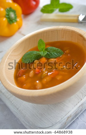 Wooden bowl with mexican bean soup - stock photo