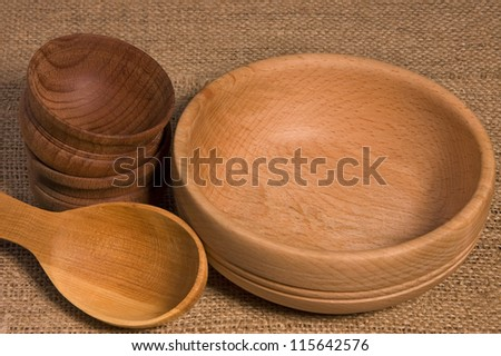 Wooden bowls and spoon on burlap