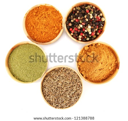 wooden bowls with spices isolated on white - stock photo