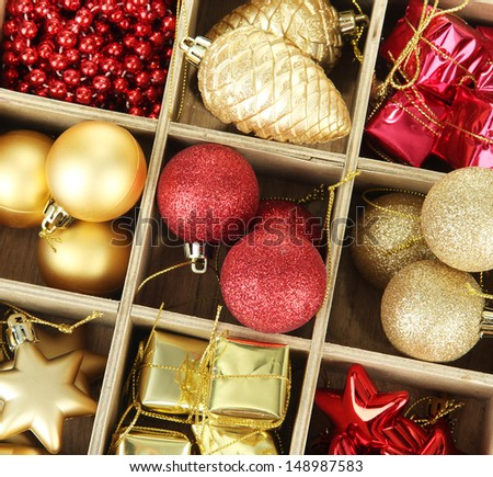 Wooden box filled with christmas decorations, isolated on white