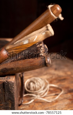 Wooden box filled with very old rusty tools