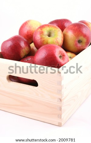 wooden box full of red apples isolated on white