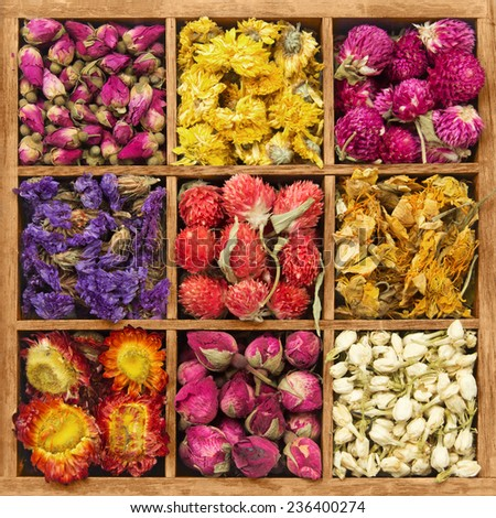 Wooden box with assorted flower tea - stock photo