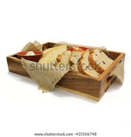 Wooden box with bread slices. Isolated photo on white background.
