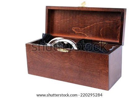 Wooden box with different jewels on white background