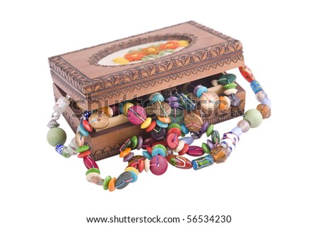 wooden box with fashion beads on white background - stock photo