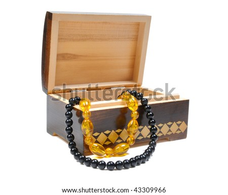 wooden box with jewelry on a white background
