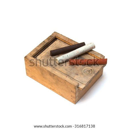Wooden box with material for drawing. On a white background