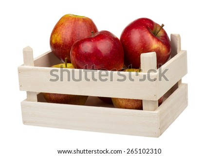Wooden box with red apples isolated.
