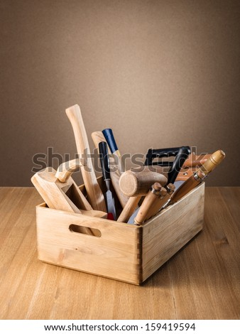 Wooden box with tools on the table - stock photo