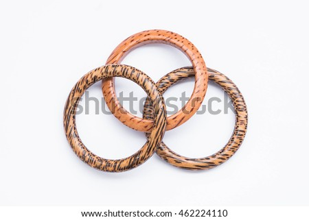 Wooden bracelets on white background