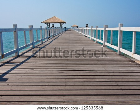wooden bridge at a beautiful beach on sunny day in Thailnd