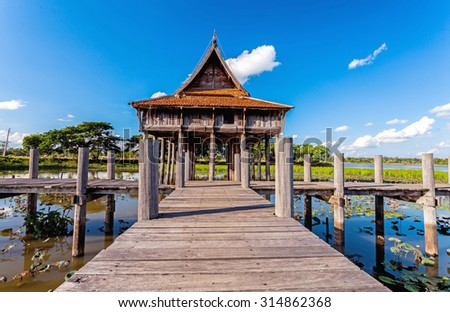 Wooden bridge at Thai wooden temple architecture on Park NongKhulu in UbonRatchathani province, Thailand