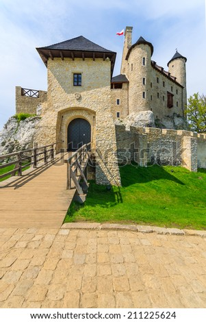 Wooden bridge entrance to beautiful Bobolice medieval castle on sunny day, Poland