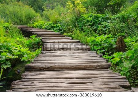 Wooden bridge footpath in Plitvice Lakes National Park . Croatia - stock photo