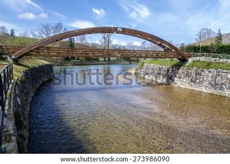 Wooden bridge in Cangas de Onis, on river Guena. Asturias Spain - stock photo