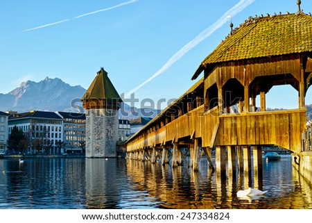 Wooden bridge in Lucern city under beautiful morning. Lucern is a very beautiful ancient town in Switzerland. - stock photo