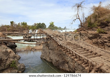 Wooden bridge in the Khone Phapheng Waterfall, Champasak Province on the Mekong River in southern Laos