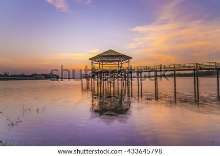 Wooden bridge in the sunset