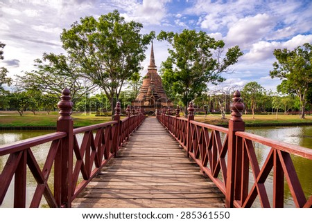 Wooden bridge in Wat Mahathat Sukhothai Historical Park ,Sukhothai ,Thailand - stock photo