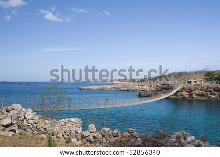 Wooden bridge on a rocky seashore, in Cienfuegos, Cuba
