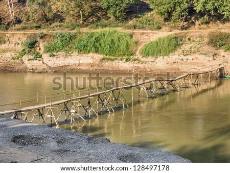 Wooden Bridge on Nam Khan River, Luang Prabang - stock photo