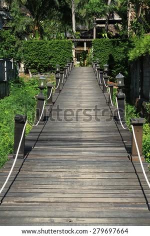 Wooden bridge on the river in krabi ,thailand - stock photo