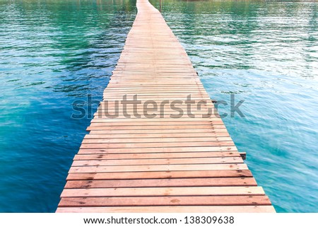 Wooden bridge on the way to the harbor. - stock photo
