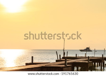 Wooden bridge on the way to the harbor in Sunset time at Ko Mak island, thailand - stock photo