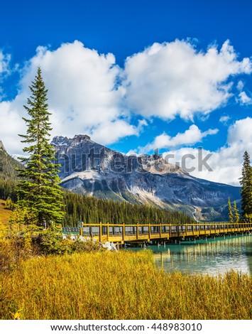 Wooden bridge over Emerald Lake. British Columbia, Yoho National Park, Rocky Mountains - stock photo