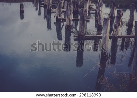 wooden bridge over the river and sky in river vintage - stock photo